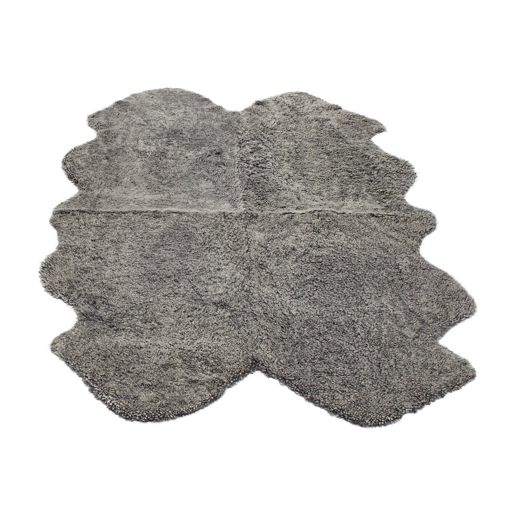 Light grey large sheepskin rug