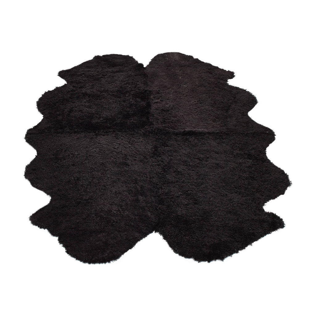 Black large sheepskin rug