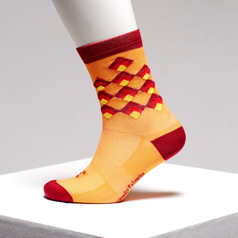 Red and orange colourful sports socks by The Wonderful Socks on Omnium