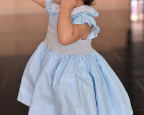 Light blue hand smocked dress model By Charmy Charmy.