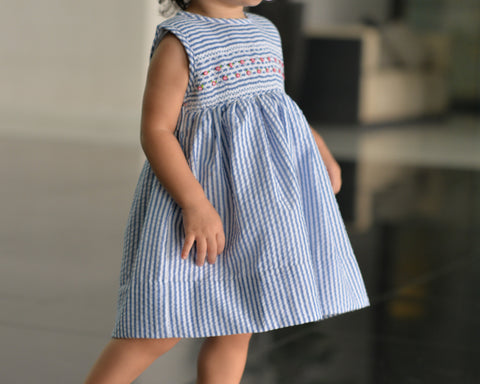 blue white stripe smocked dress model
