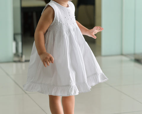 white smocked dress model