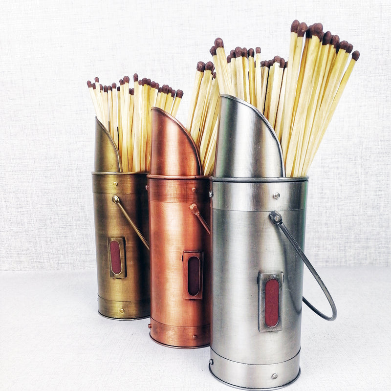 Matchstick holders bronze pewter copper against grey background