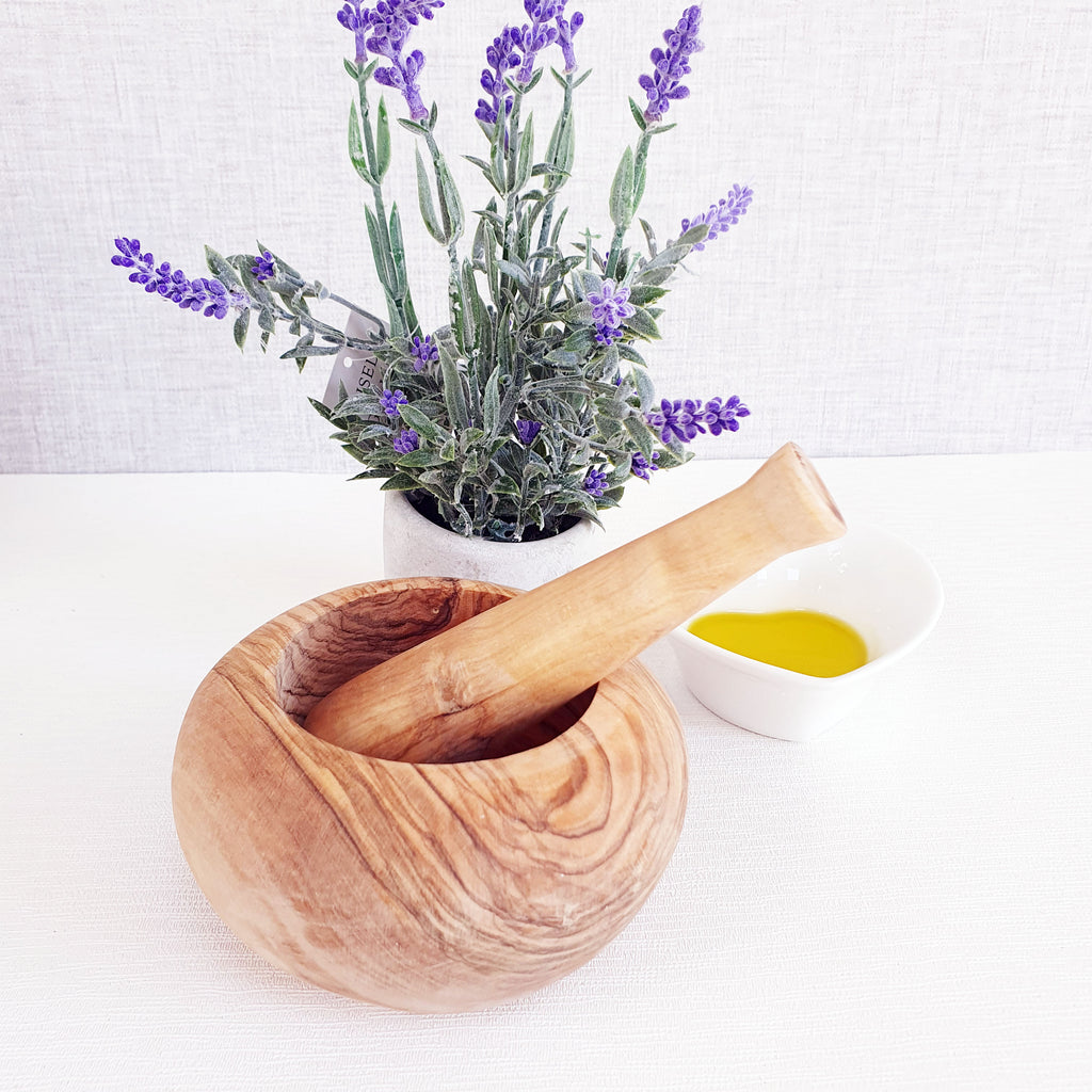 Olive wood pestle and mortar with oil an dlavendar