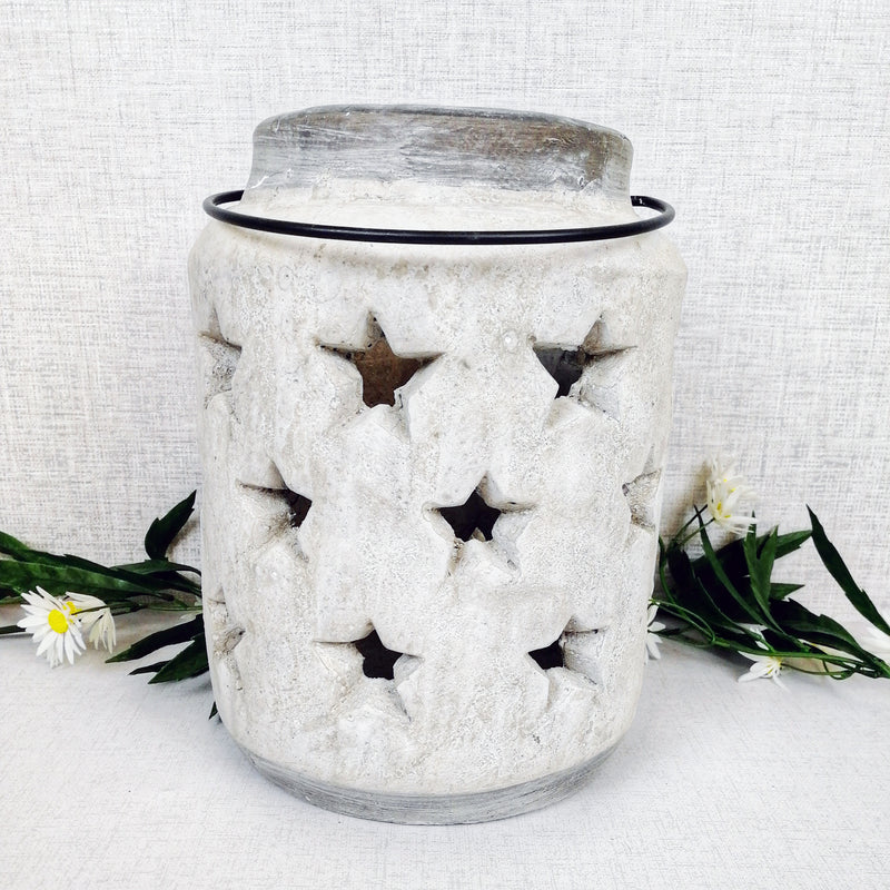 Stoneware Style Star Candle Lanterns in front of flowers