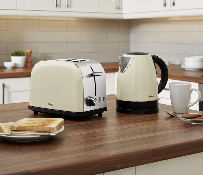 Cream Swan Camden 1.7L Jug Kettle next to the Cream Swan Camden 2-Slice Toaster on wooden kitchen countertop