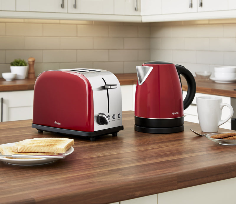 Red Swan Camden 1.7L Jug Kettle next to the Red Swan Camden 2-Slice Toaster on wooden kitchen countertop