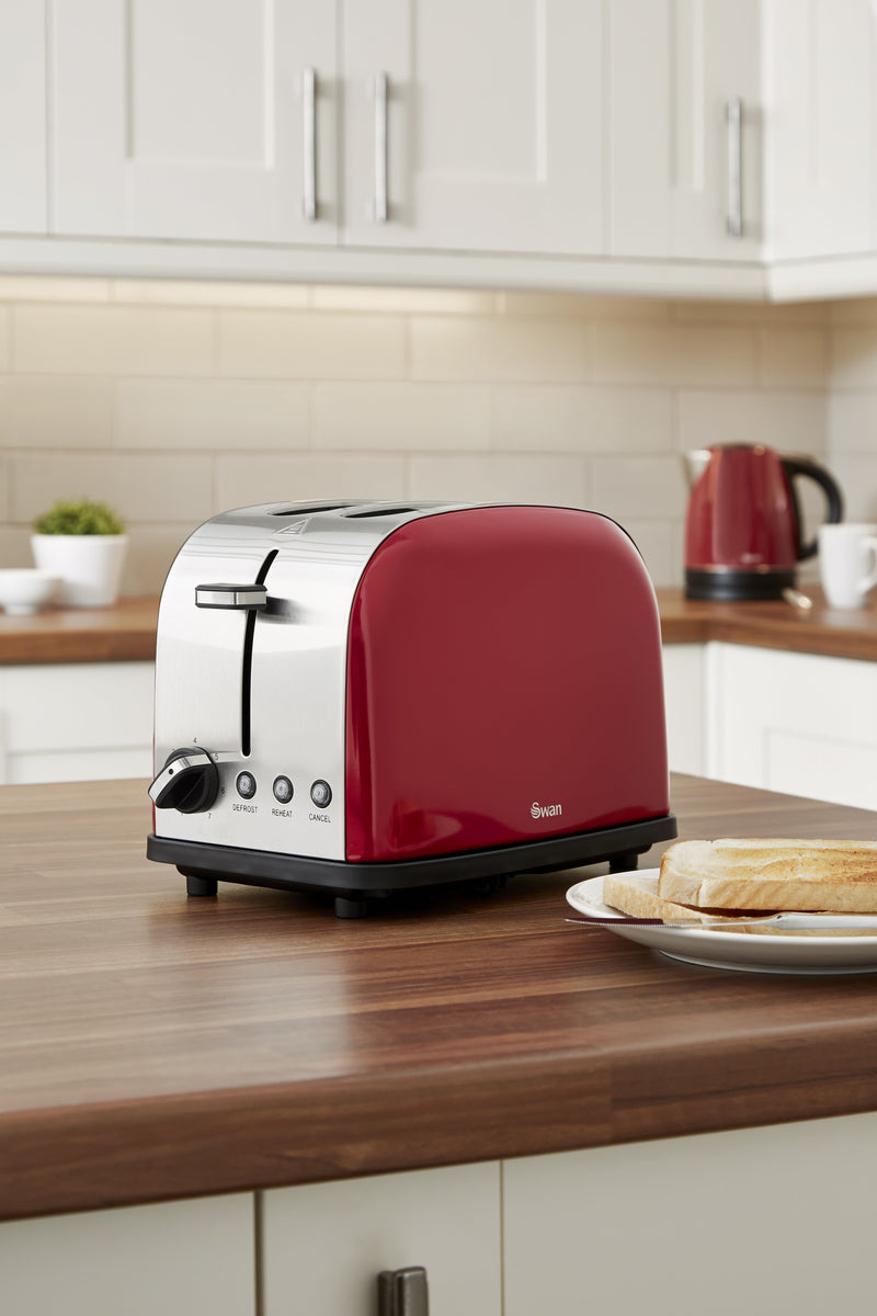 Red Swan Camden 2-Slice Toaster on wooden countertop next to a plate of toast