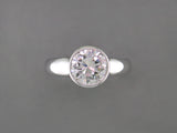 ROUND DIAMOND RING WITH BEZEL SETTING