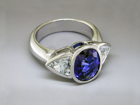 OVAL BLUE SAPPHIRE & TRILLION DIAMOND RING