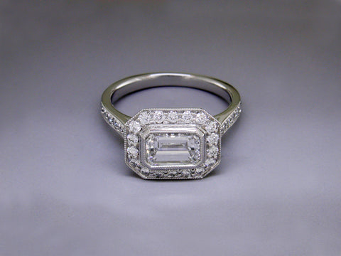EMERALD CUT DIAMOND RING WITH PAVE BAND