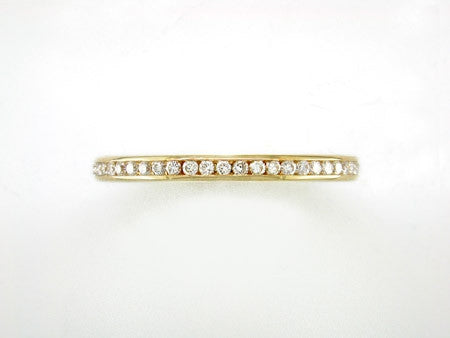 DIAMOND & YELLOW GOLD ETERNITY RING