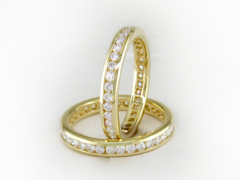 PRINCESS CUT DIAMOND YELLOW GOLD ETERNITY RING