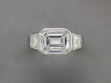 EMERALD CUT & TRAPEZOID DIAMOND RING
