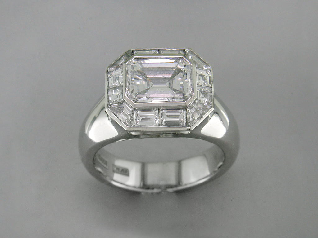 EMERALD CUT DIAMOND RING WITH BAGUETTE & TRAPEZOID DIAMOND SURROUND