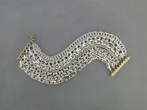 7-STRAND SILVER BRACELET WITH YELLOW GOLD CLASP