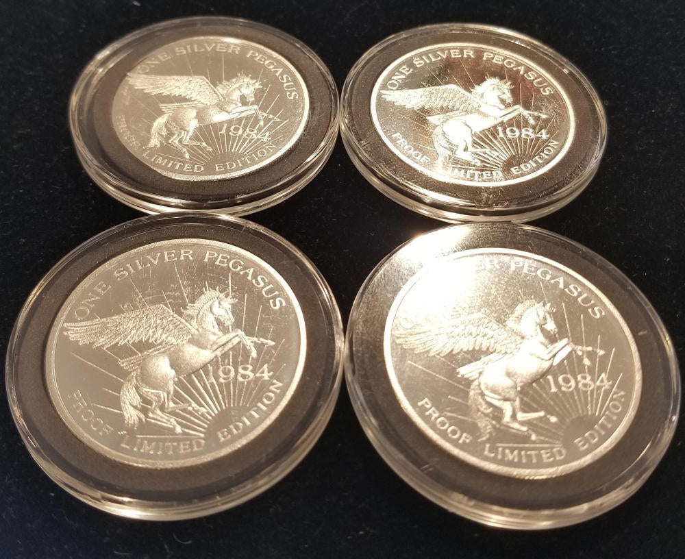Lot of 4. 1984 Pegasus Gold Company Silver Rounds, in Caps. PROOF! Spokane WA