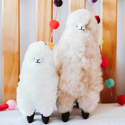 alpaca-stuffed-animals-standing-white-alpaca-on-bedside-table-pokoloko