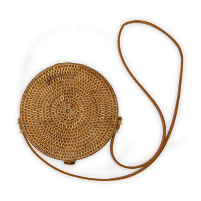 pokoloko-womens-bali-bag-caramel-circular-woven-rattan-vegan-leather-straps-and-buckle-studio-white-background