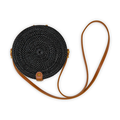 pokoloko-womens-bali-bag-black-circular-woven-rattan-brown-vegan-leather-straps-and-buckle-studio-white-background
