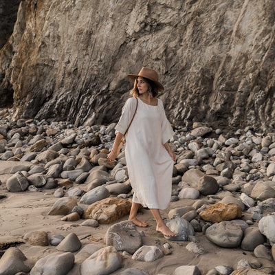 pokoloko-womens-classic-dress-natural-walking-looking-over-shoulder-beach