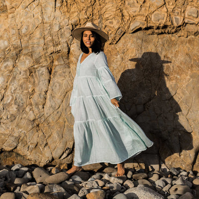 pokoloko-womens-long-dress-soft-mint-standing-on-rocks-sunshine-v-neck-bell-sleeves-a-line-smiling