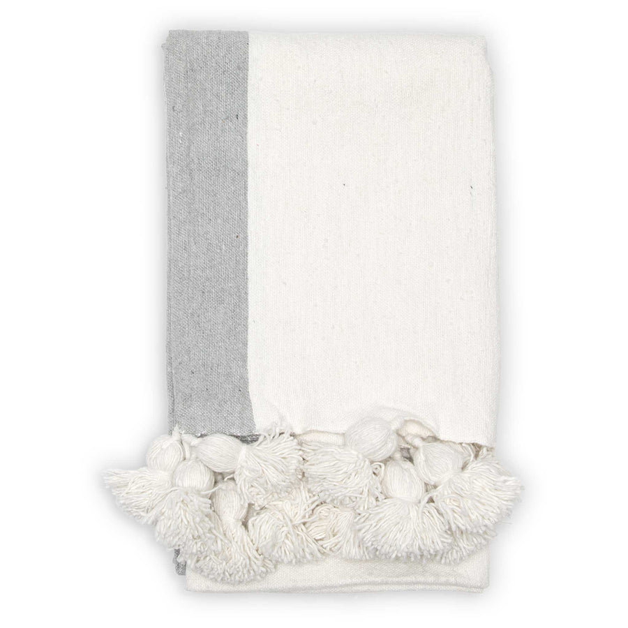pokoloko-bordered-white-pom-pom-blanket-folded