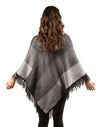 alpaca-triangle-poncho-shadow-on-model-facing-back-pokoloko