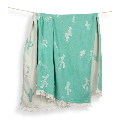 pokoloko-cactus-jacquard-towel-hanging-from-rope