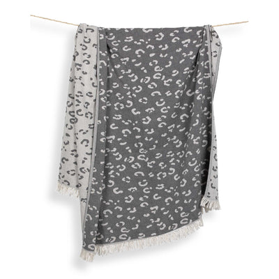 pokoloko-leopard-jacquard-turkish-towel-drapped-from-rope