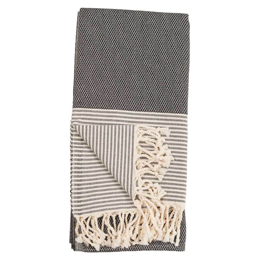 patek-turkish-towel-folded-together-on-table-pokoloko