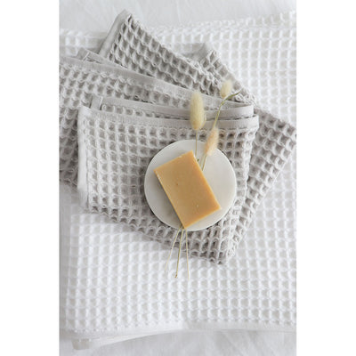 pokoloko-waffle-turkish-towel-white-towel-with-light-grey-pokoloko-waffle-hand-towel-on-table
