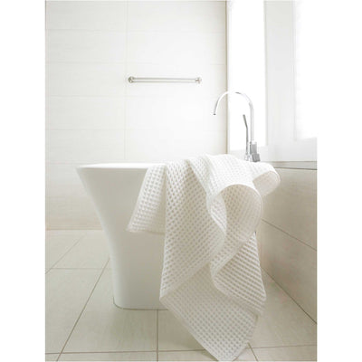 pokoloko-waffle-turkish-towel-white-color-drapped-on-end-of-bath-rub-in-bathroom
