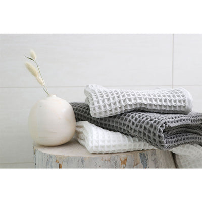 pokoloko-waffle-turkish-towels-white-light-grey-and-dark-grey-colors-piled-on-wooden-stool