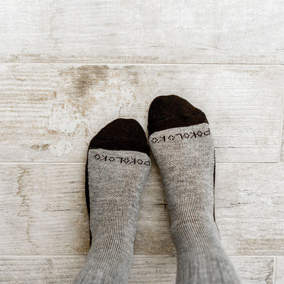 alpaca-hiker-pokoloko-socks-black-and-grey-washed-grey-floor