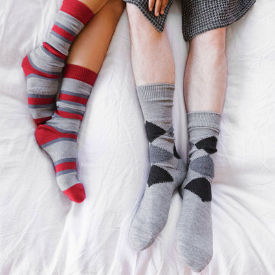 striped-alpaca-pokoloko-socks-grey-color-on-model-feet-on-bed