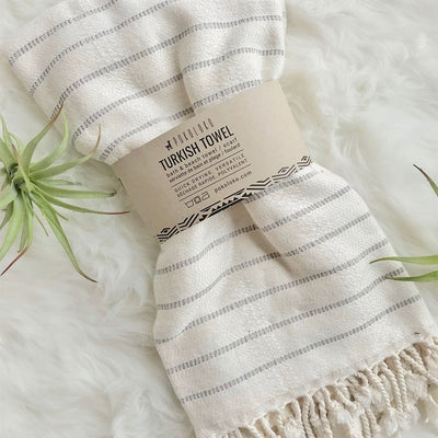 pokoloko-striped-bamboo-turkish-towel-mist-color-folded-in-belly-band-on-fur