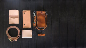 aged natural veg tan wallet belt and bracelet with patina