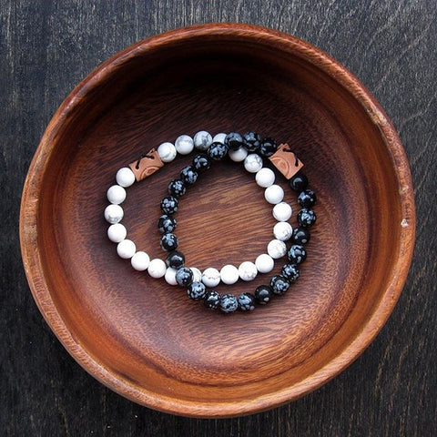 Mens beaded bracelets in wooden bowl
