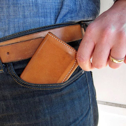 worn natural vegetable tanned leather wallet