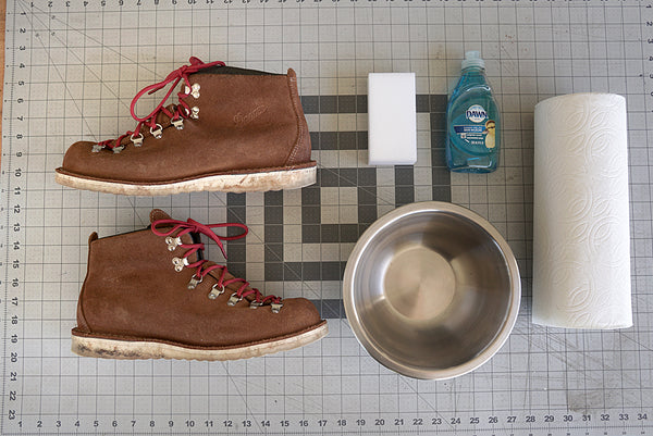 danner mountain light boots with cleaning supplies