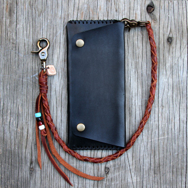 Brown round leather lanyard with black trucker wallet