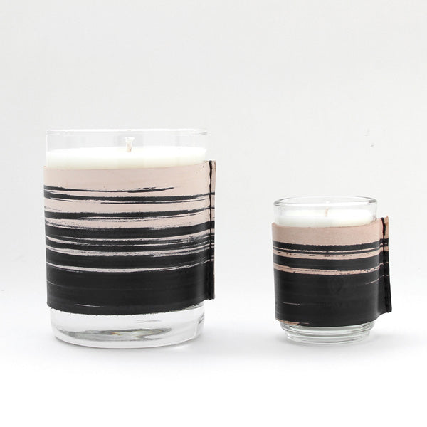 Large and small leather wrapped scented candle