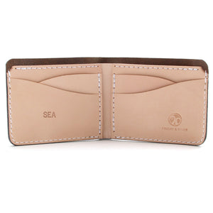 Monogrammed brown leather wallet