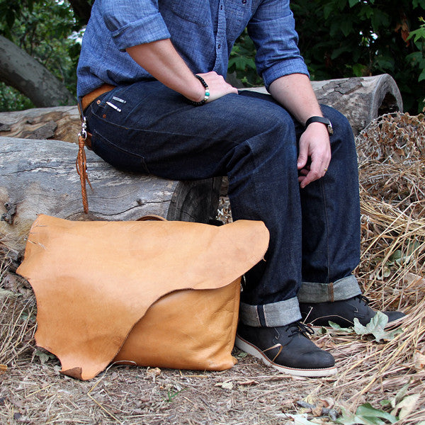 Leather messenger bag with selvedge denim and red wing boots