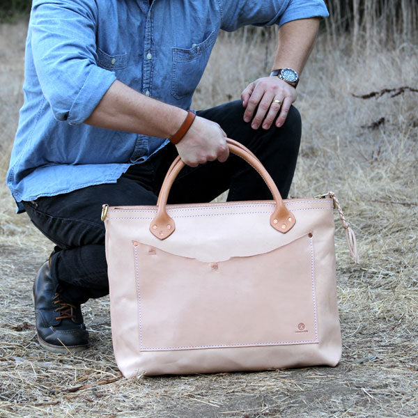 Large veg tan leather bag with denim outfit