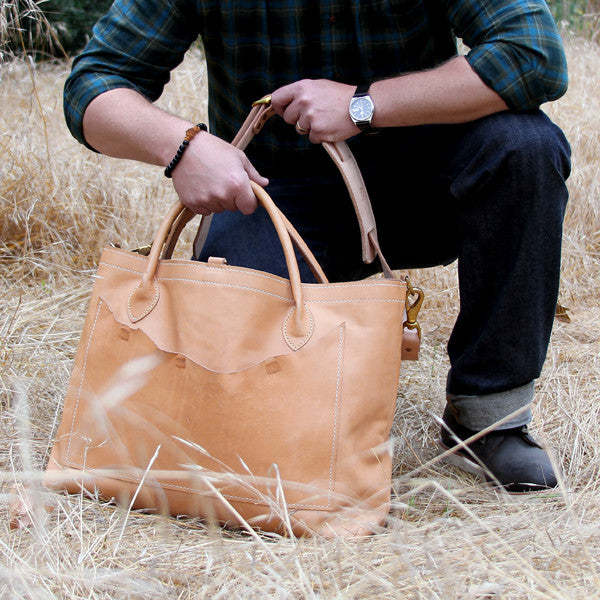 Large veg tan bag with man
