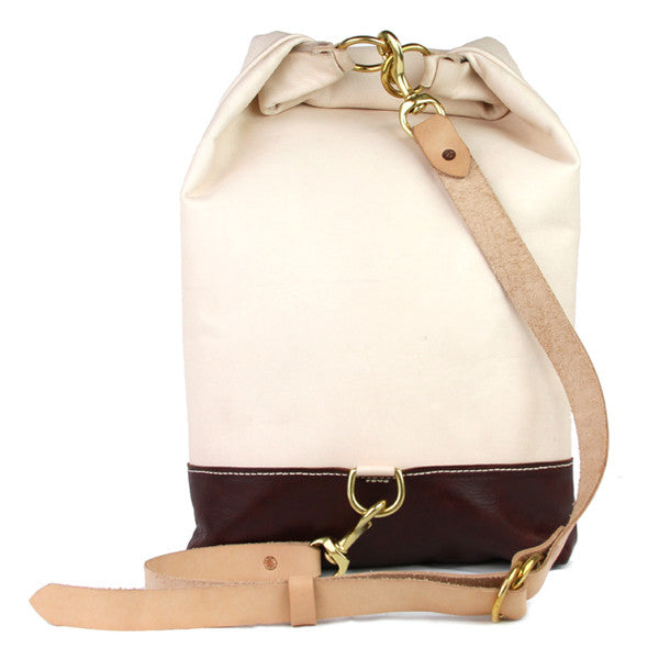 Leather sling backpack back with leather strap