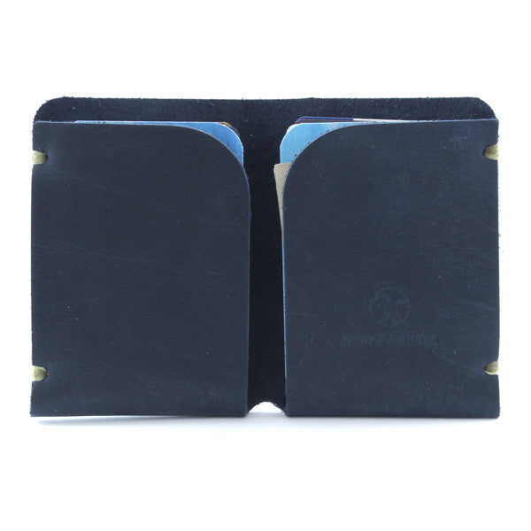 Minimal blue indigo leather card case open with cards