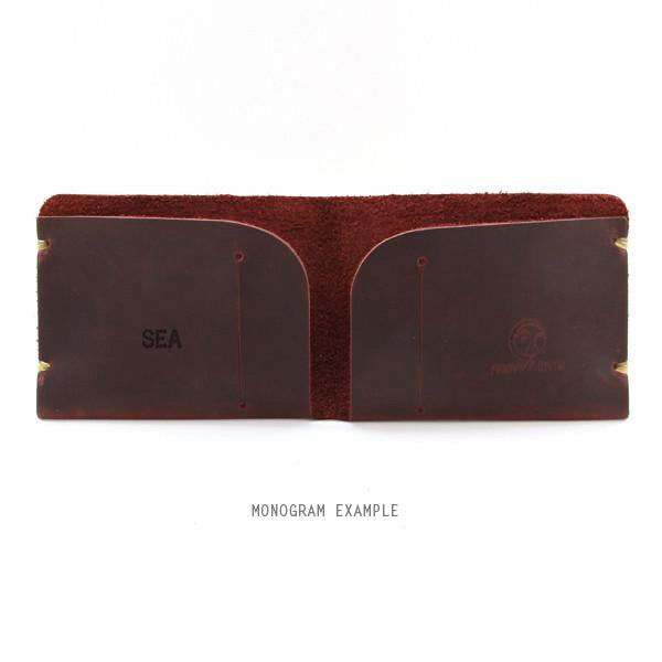 Brown leather monogrammed wallet